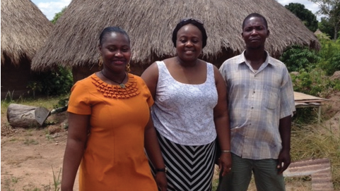 Iwu (center) with health care colleagues at a primary care center in rural Benue State.