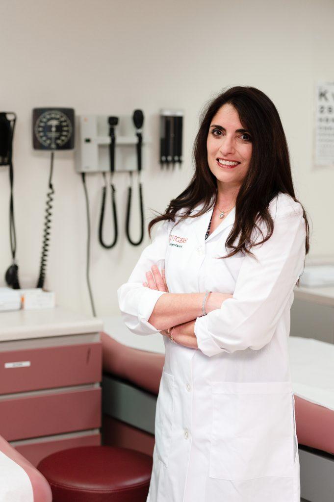 Margaret  Quinn in a lab coat